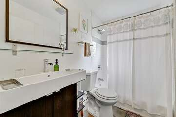 Bathroom with tub/shower combo and designer fixtures