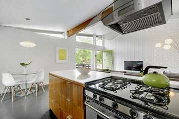 Open kitchen, dining, and living room is perfect for conversation while making meals.