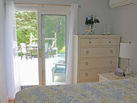 The bedroom offers glass sliding doors to the back deck - 425 Paines Creek Brewster Cape Cod - New England Vacation Rentals