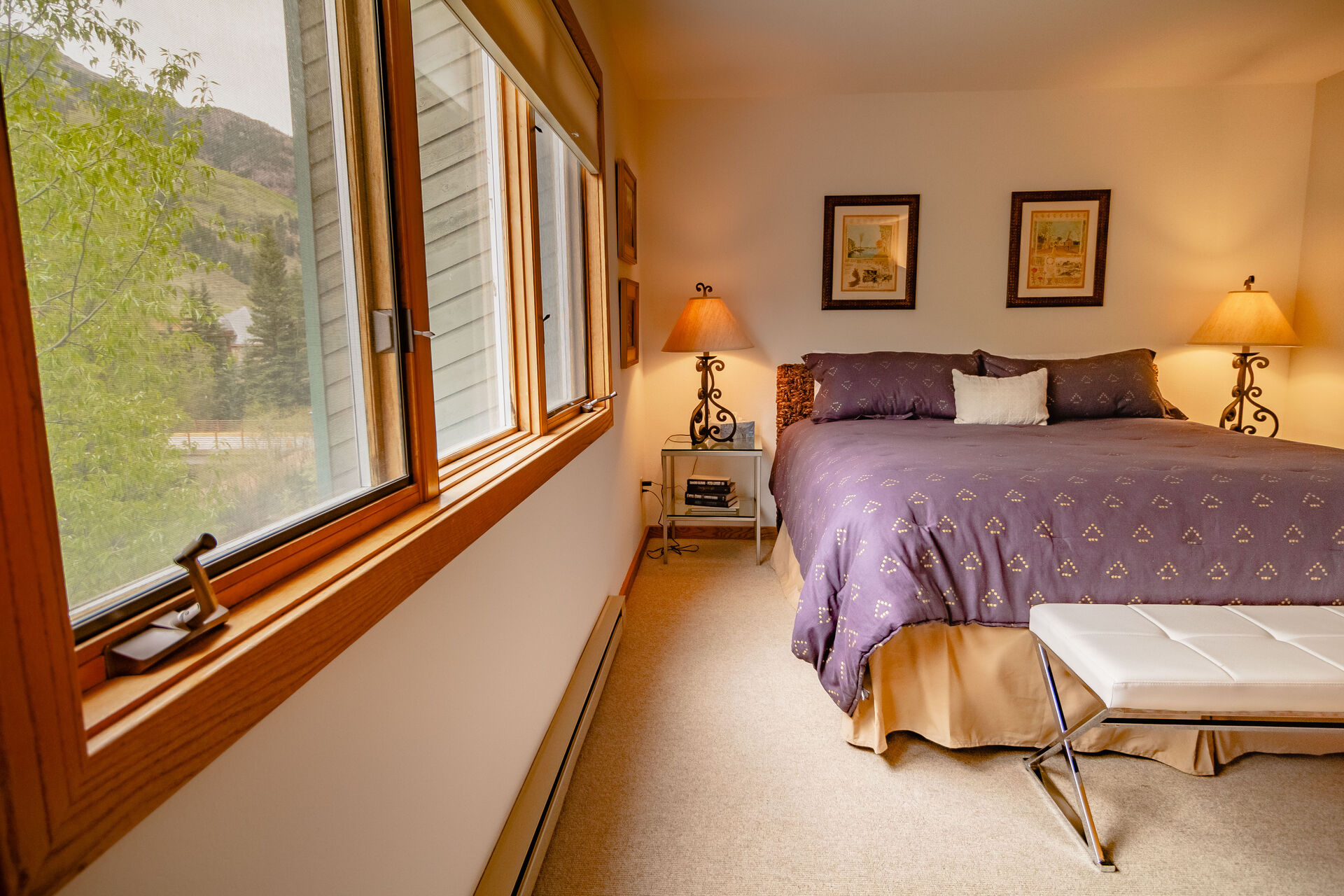 Bedroom with Large Windows and Views of the Forest at Riversdie D203