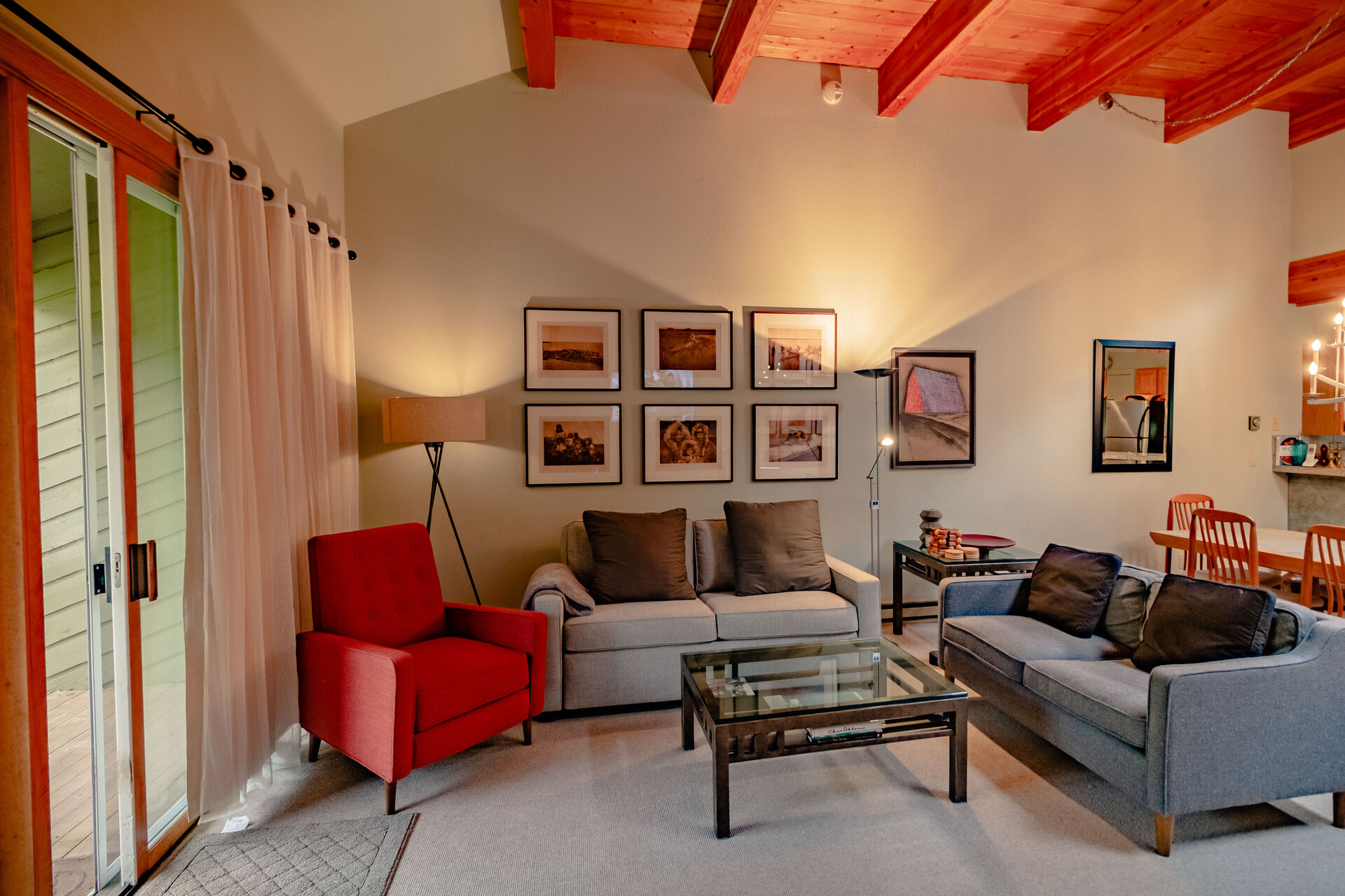 Living Area with High Ceilings and Wood Cross Beams
