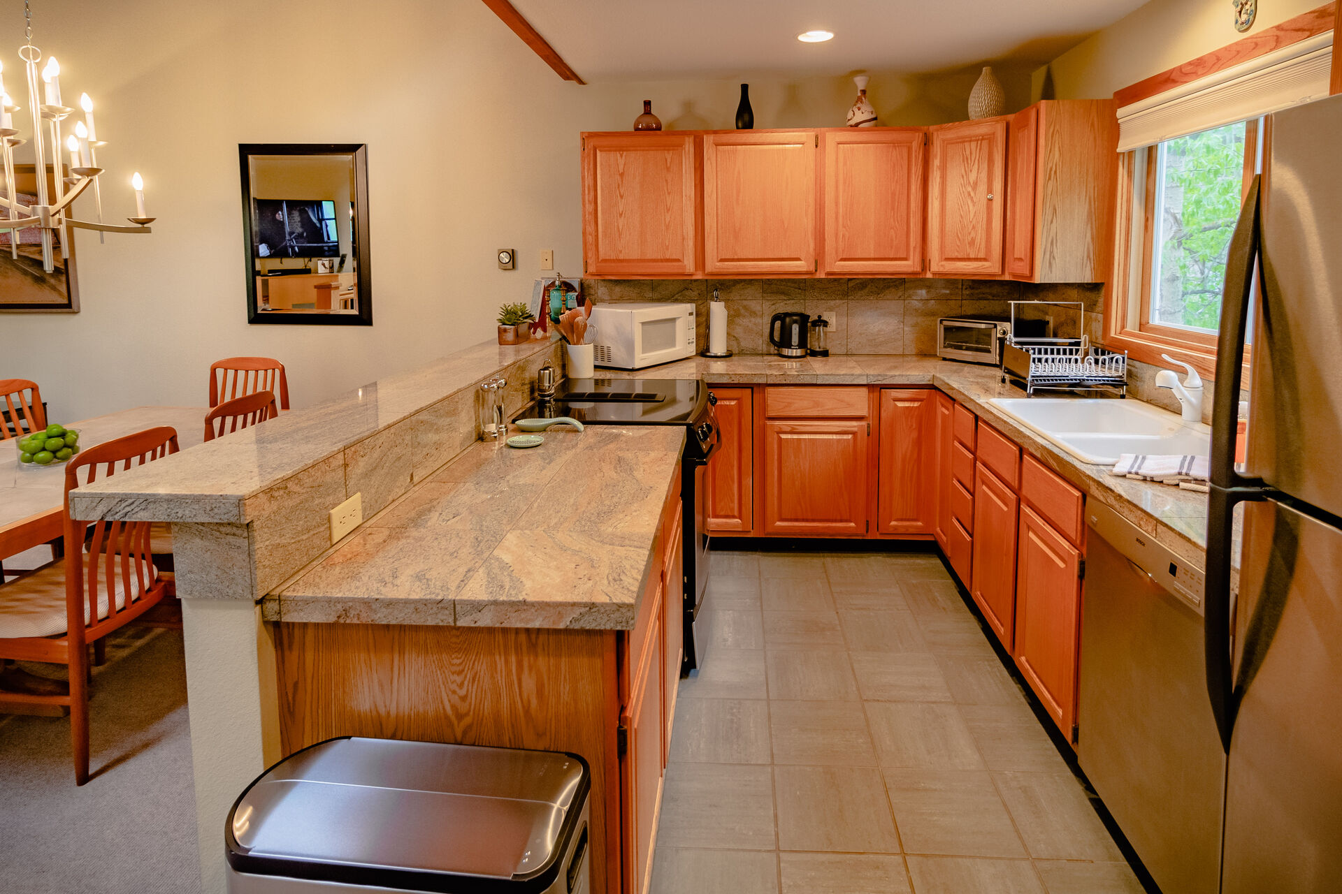 Fully Equipped Kitchen with Stainless Steel Appliances and Wooden Cabinets at Colorado Vacation Cabin