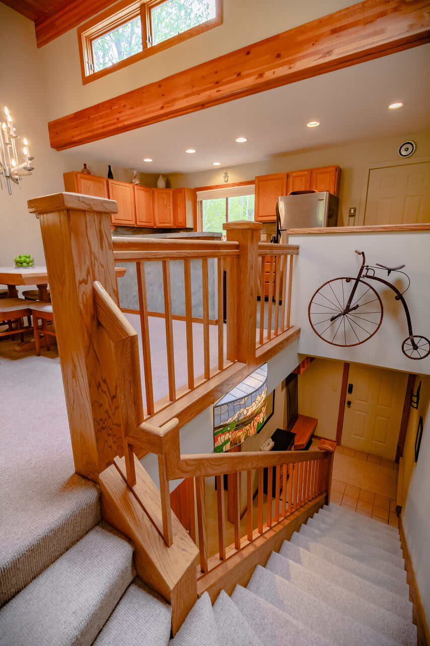 Staircase with Bicycle Wall Art Leading to the Lower Level