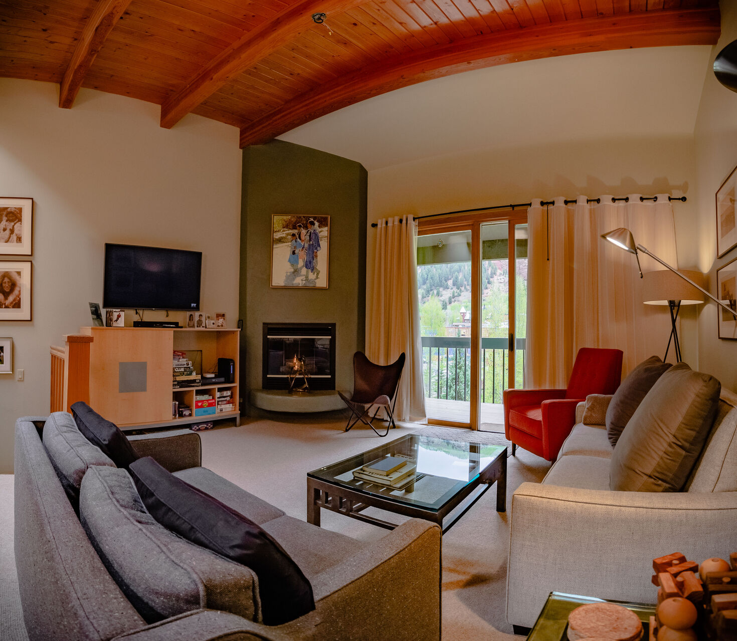 Living Area with Patio Access and Fireplace at Colorado Vacation Cabin