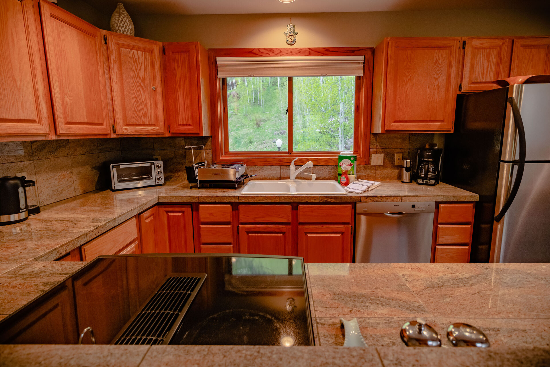 Full Kitchen with Wrap-Around Counter Tops and Stainless Steel Appliances at Colorado Vacation Cabin
