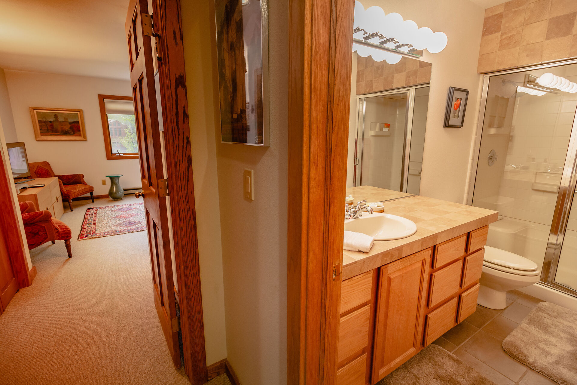 View of Bathroom and Master Bedroom at Riverside D203