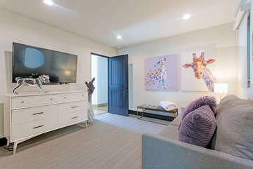 Entertainment Room W/ pull out Queen Bed. Large Smart TV.