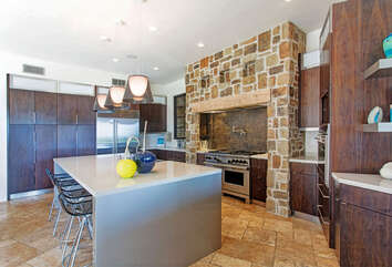 Kitchen with large stove.