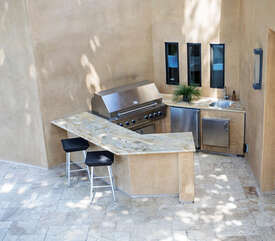 Kitchen Patio with BBQ, mini frig and seating.