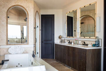 En suite with jetted tub. His and hers sinks.