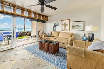 A living room and access to the lanai
