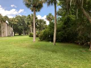 Look to the left from the patio to see the 9th fairway of Ocean Winds Golf Course.