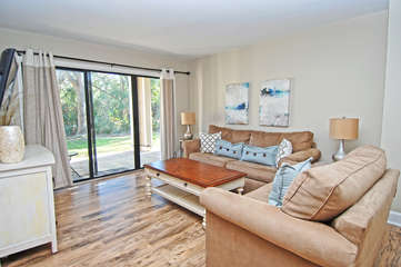 Hardwood floors, beautifully decorated and appointed.  Sliding glass doors lead to the covered patio.