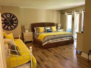 The pretty master bedroom has a daybed with a trundle.