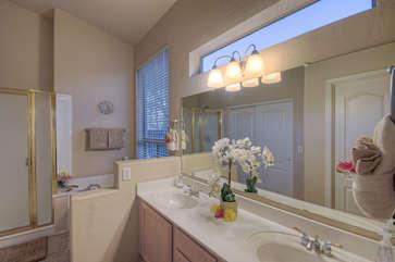 Modern master bathroom features walk-in shower with glass door