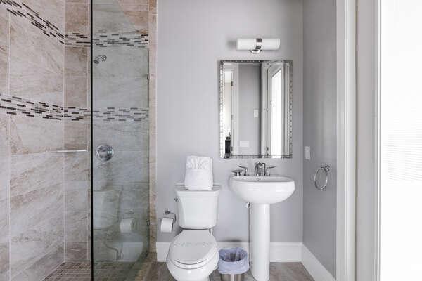 En suite bathroom with glass door and walk-in shower