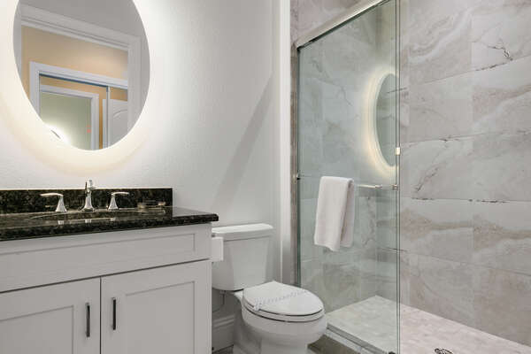 En suite bathroom features a walk-in shower