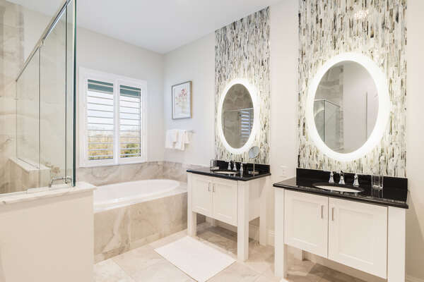 Master en suite bathroom with glass walk-in shower and garden tub