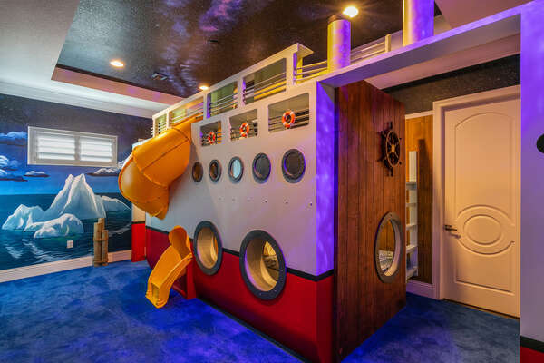 The Atlantic Adventure Suite features a full/full bunk bed, a twin/full bunk bed, and a fun slide