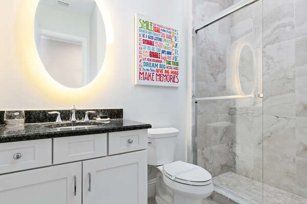 The en suite bathroom features a walk-in shower