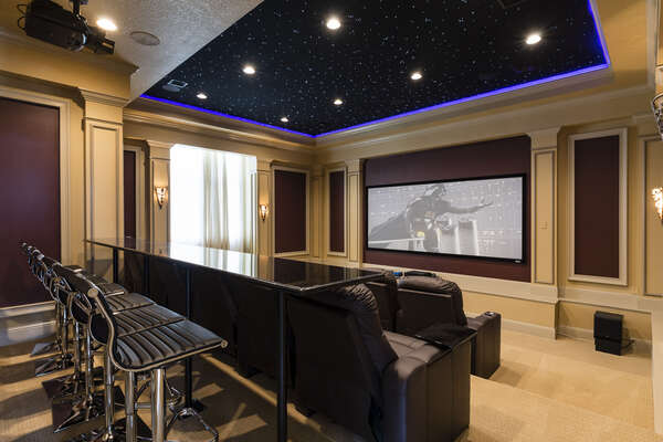 Watch your favorite movie in the theater room with seating for 20, Apple TV, and SMART DVD Player