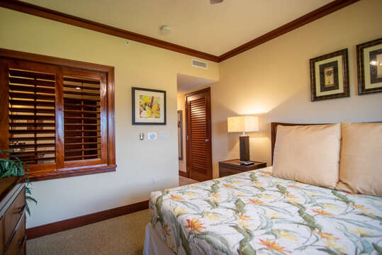 Master Bedroom with Warm Decor in our Ko Olina Condo on Oahu