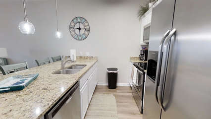Kitchen with Large Island, Granite Countertops and Stainless Steel Appliances
