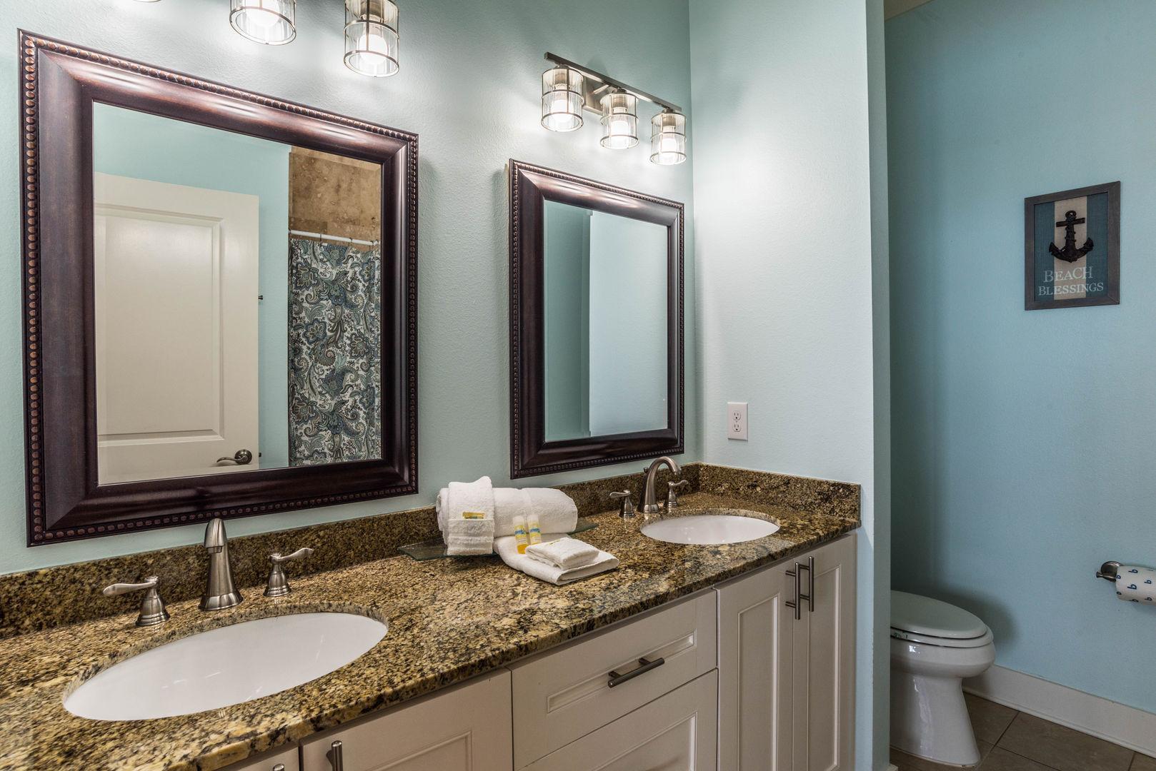 Bathroom with a Granite Top Double Vanity
