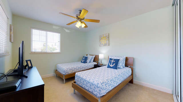Upstairs Bedroom with Nautical Theme and Flat Screen TV