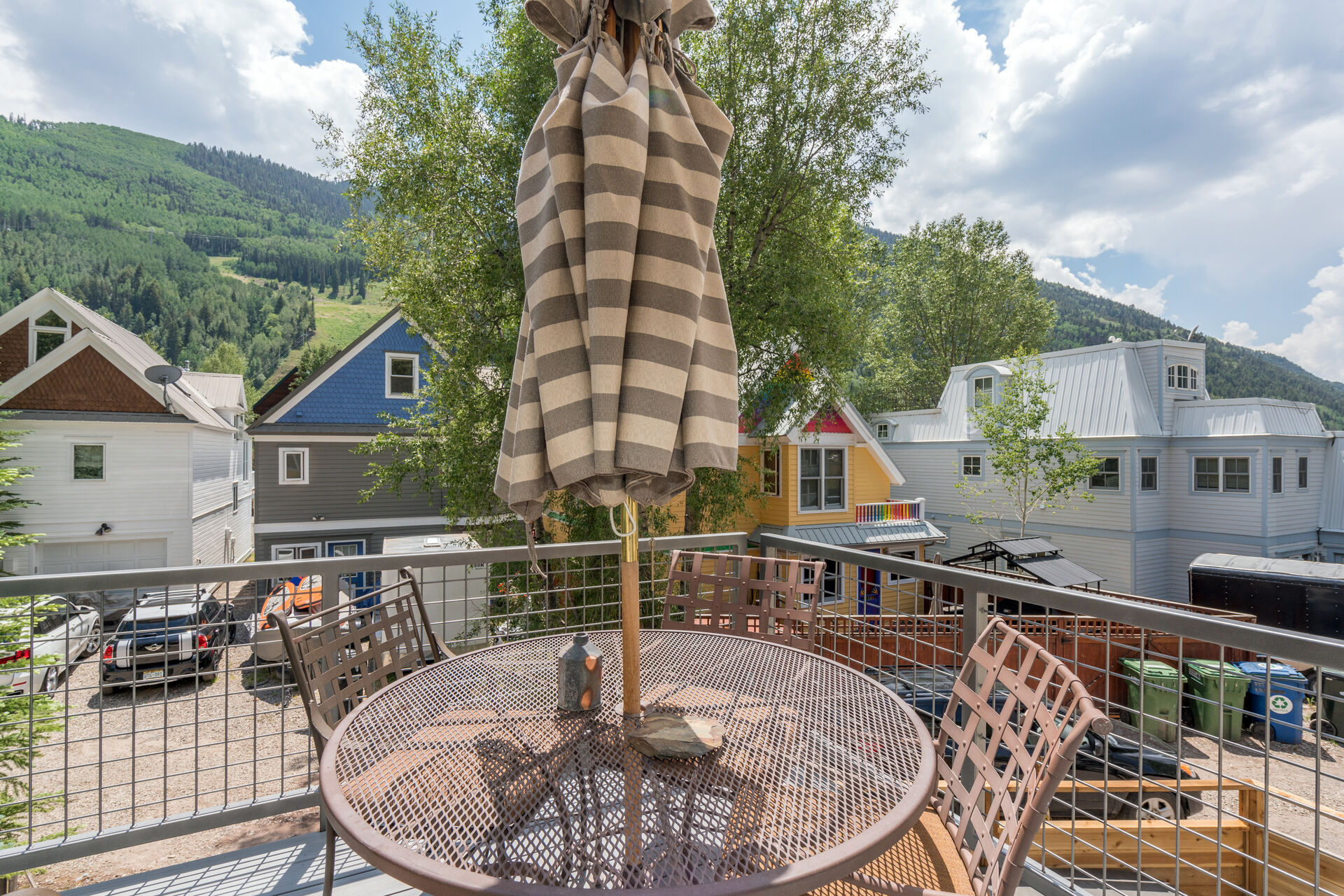 Patio with Seating and Views of the Mountainside at Bachman Village #13