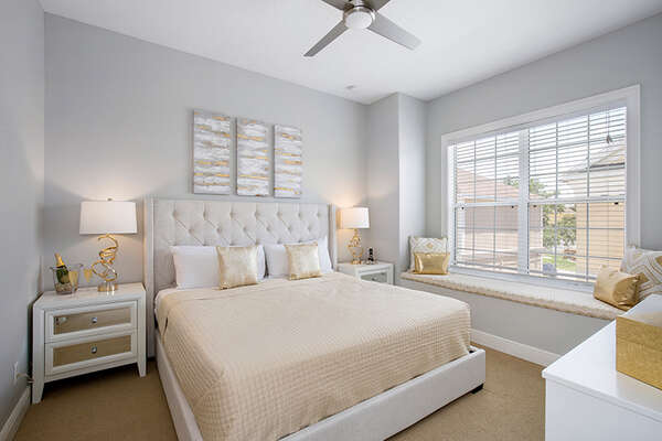 The second-floor master suite features a king size bed, reading nook, and en-suite bathroom.
