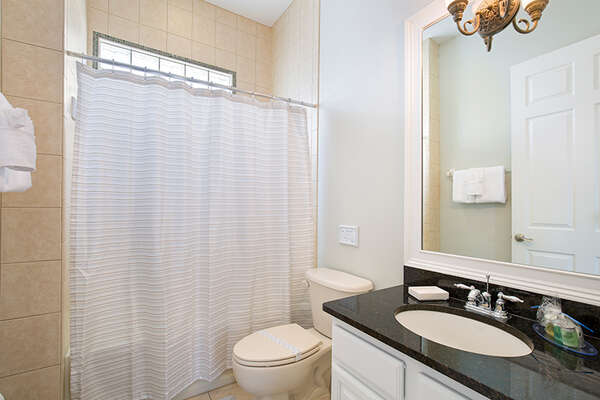 A full bathroom located on the second floor.