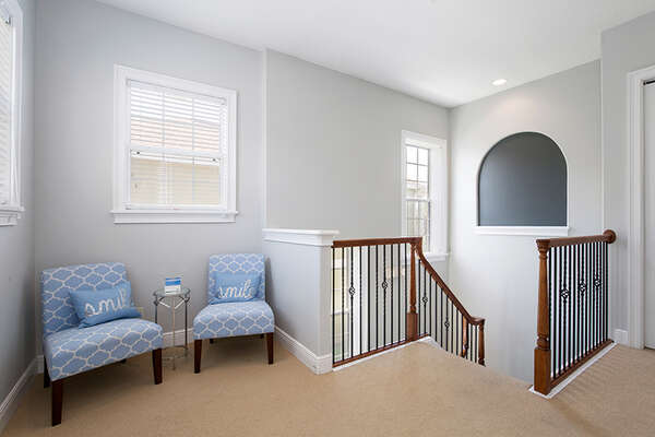 A small seating area on the second floor.