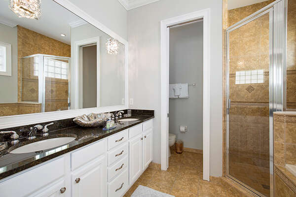 The en-suite bathroom features dual vanity and walk-in shower.
