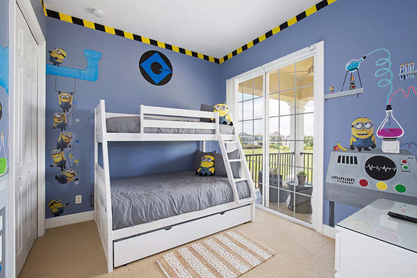 A fun kids bedroom with a twin over full bunk bed.
