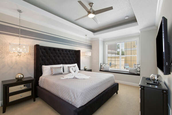 The first master suite on the ground floor features a king size bed and en-suite bathroom.