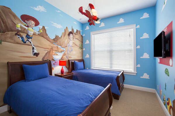 Another fun kids bedroom features two twin beds.