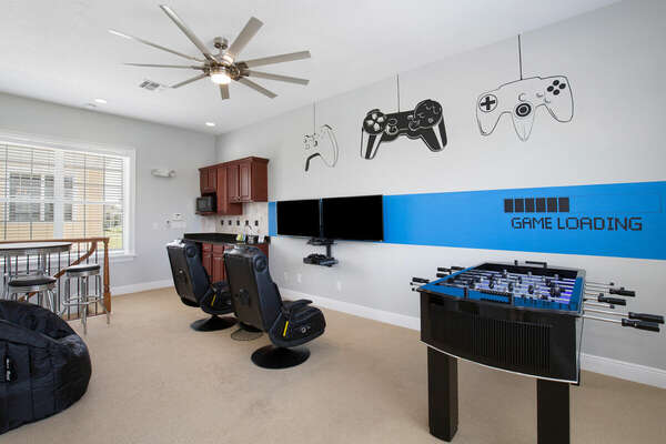 The loft area features a foosball table, PlayStation 4, Xbox One, 2 - 42-inch TV, and kitchenette.