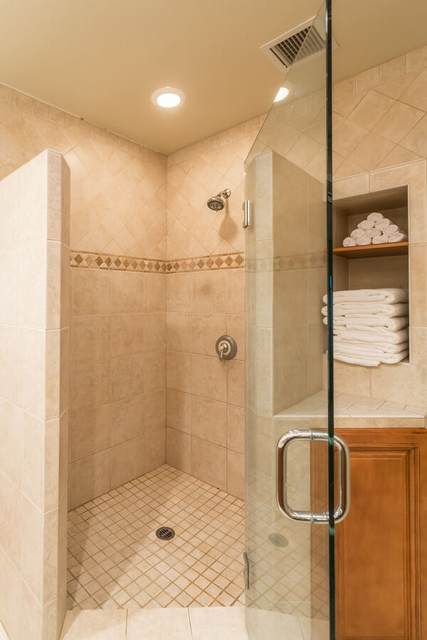 A custom built shower in the master bedroom is huge and ready to spell relaxation for you!