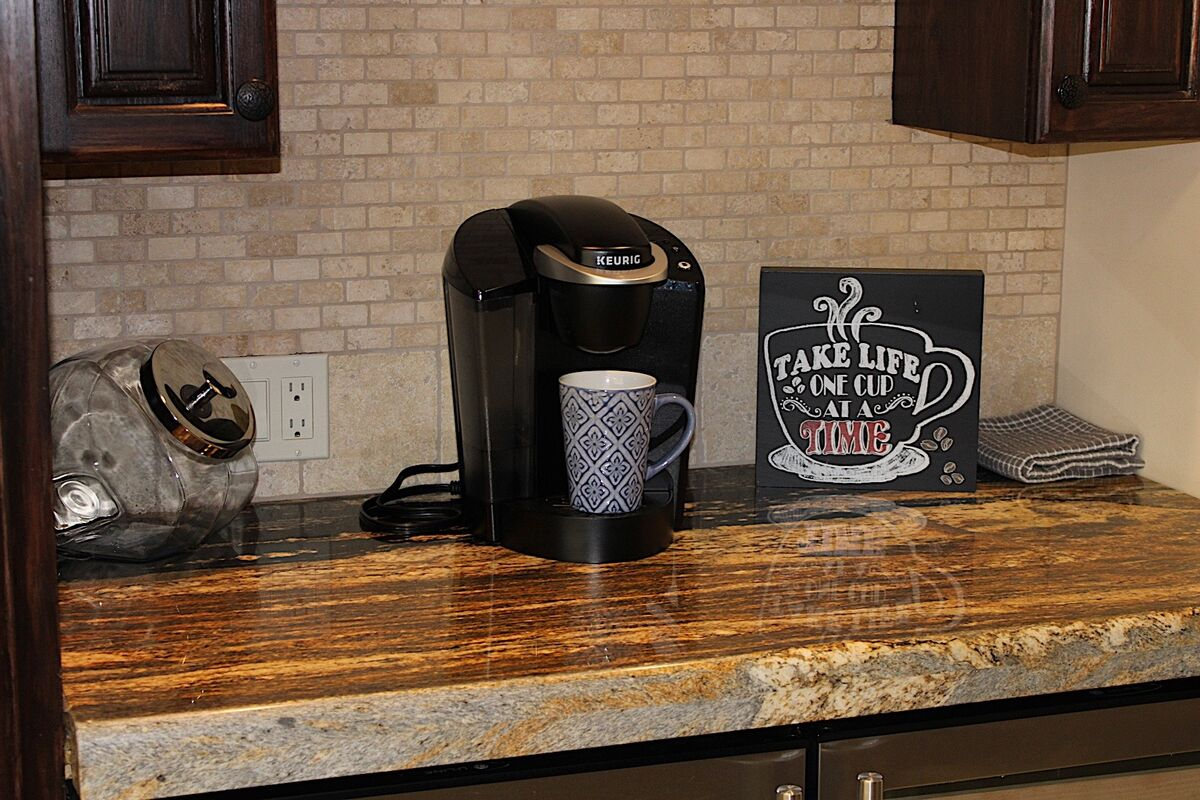 Grab yourself a nice cuppa at this coffee nook, or reach below into the wine fridge to grab a good time!