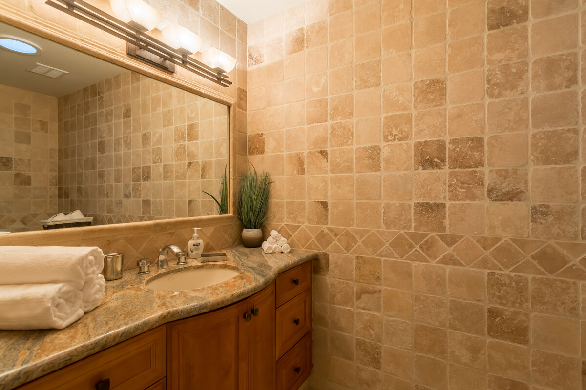 Tranquil guest bathroom with a sky light to bring in the natural light