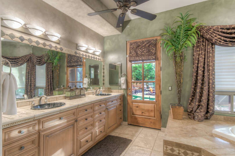 Enjoy dual vanities and a personal exit into the backyard.