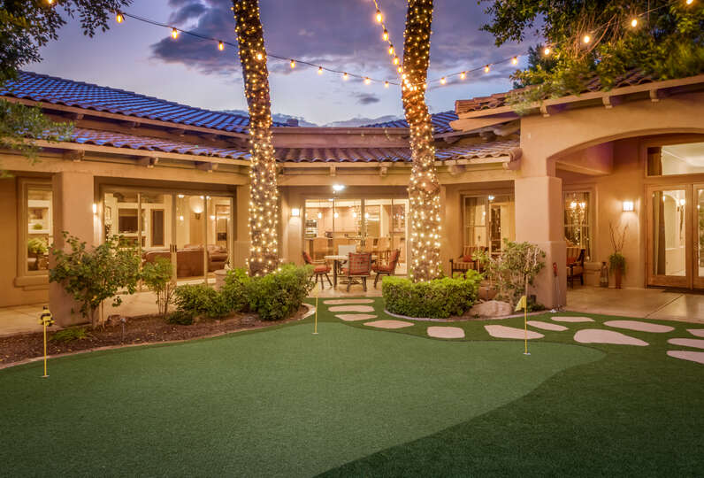View Across the Putting Green Toward the Main Patio and Living Area