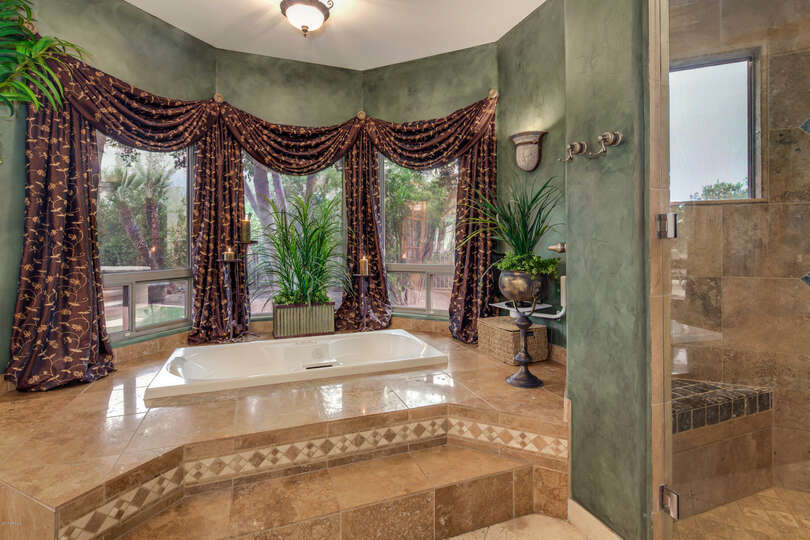 Step up into the bathtub framed with the premium drapes.