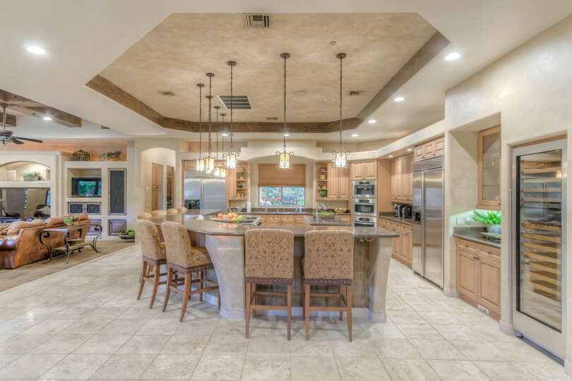 The kitchen is the cornerstone of the home built with top of the line appliances and seating for 8.