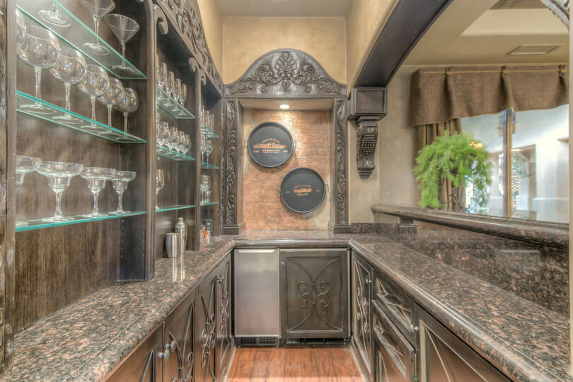 The built-in wet bar is perfect for those who want a drink after a long day out.