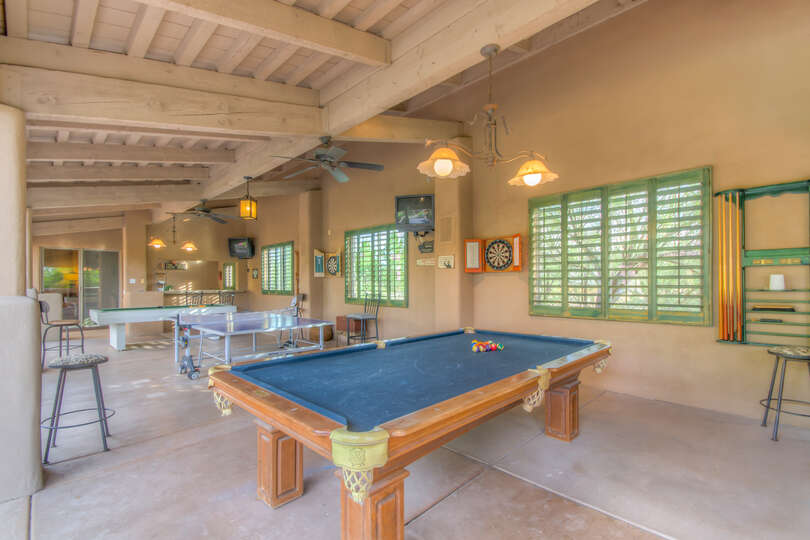 With a ping pong table, 2 pool tables, and built-in TV's the outside is made for entertainment.