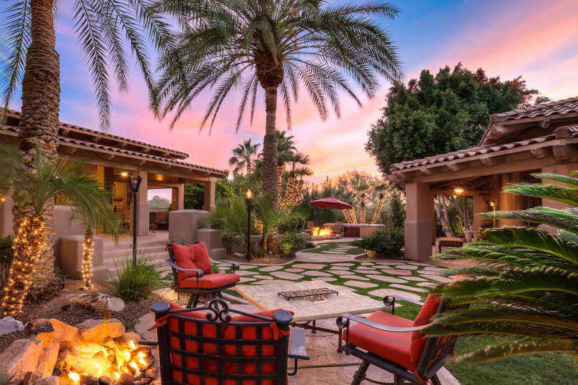 A cozy sitting area by the outdoor fire pit