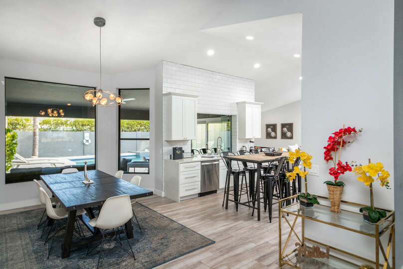 Open floor plan with full kitchen and dining room.