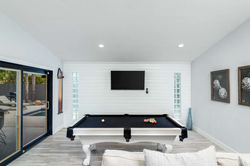 Enjoy a game of pool while you watch the game!
